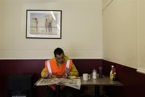 Construction worker Ray Anderson eats breakfast at The Griddlers Cafe on the Regent's canal in east London March 19, 2012. London will host this summer's 2012 Olympic Games. REUTERS/Stefan Wermuth (BRITAIN - Tags: SPORT OLYMPICS TRAVEL)